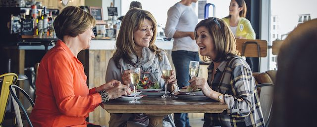 ladies drinking wine with lunch blog on health benefits